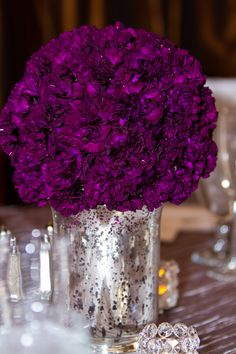 Purple flower mercury vase centerpiece