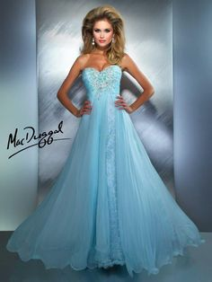 The beading on this prom dress is so modern, and the skirt is so feminine.  It's beautiful!  Gigi's Closette