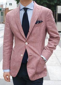 Pink jacket, knit tie.