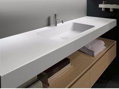 Lavabo in Corian® con piano ARCO by Antonio Lupi Design