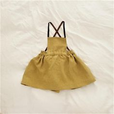 Mustard Linen Pinafore Dress / Apron Dress Made of vintage washed linen fabric woven of 100% Belgian flax, made in Japan. Pre-washed for softness and beautiful drapes. Natural linen ensure that your body remains cool during the summer months and warmer during the frosty winters. These