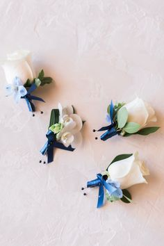 Classic White Wedding With A Little Blue Hue ~ sweet white bouts with blue accent