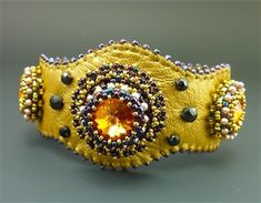 Laura Jean McCabe - Smart Cuff Bracelet kit, gold & plum. This unique design enables setting of point backed stones on leather. Kit comes with all necessary beads, crystal stones, leather, pearls, nail heads, hook and eye closure, needles and thread.