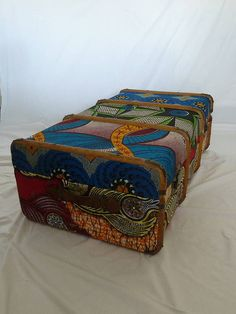 This would make a great gallery piece! DIYable: fabric covered old suitcases. Cover in fabrics that match the decor of your room and use for storage.