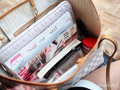 What's in my school bag- laptop + marc jacobs cover, magazines, agenda, and current favorite book!