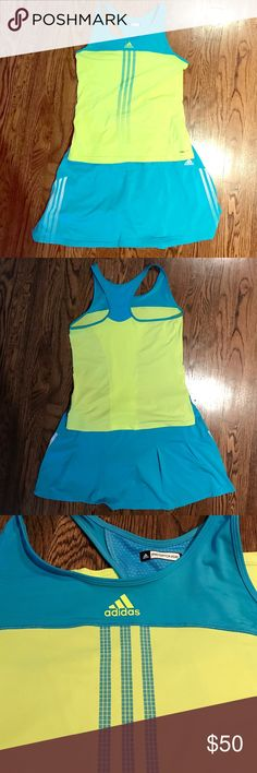 Women's Adidas Response tennis outfit Beautiful vibrant torq blue Adidas tennis skort with built in shorts and the classic three stripe white markings on sides of skirt. The skort is a size Large. I'm pairing it with a matching vibrant  yellow racerback tennis top by Adidas with matching torq blue accents. Top does not have a built in bra so it fits a bit looser. This top is a US Medium. Adidas Other