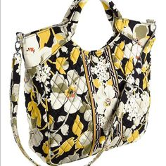 Vera Bradley Dogwood Two-way Tote Boldly patterned with a chic floral print, this roomy tote features durable roll handles and a detachable shoulder strap for convenient hands-free carrying. Interior pockets keep you organized on the go.  and  Free home No Lowballing (Please consider the 20% commission) No trades  original products Use OFFER button to make an offer  13.5'' W x 12'' H x 4'' D 5'' handle drop Maximum strap length: 53'' Outer: cotton Magnetic closure Interior pockets: three…