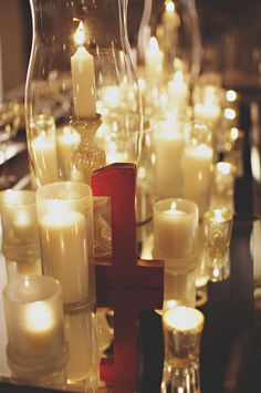 Flowerless Wedding Reception Centerpiece. All Candles. Red Glitter Table Numbers