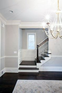 living room flooring Living Room Paint Color Ideas With Dark Floors Stairs 47 Trendy Ideas Chair Rail, Living Room Paint, Paint Colors For Living Room, Staircase Design, Grey Walls, Stairs In Living Room, Moldings And Trim, Dark Floors, Living Room Wood Floor