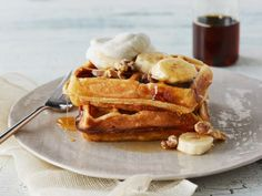 Banana Buttermilk Waffles : Mashed banana goes right into the batter to give these waffles a fruity finish. Serve them topped with whipped cream, banana slices and walnuts, and drizzle with maple syrup. Banana Waffles, Buttermilk Waffles, Pancakes And Waffles, Buttermilk Recipes, Breakfast Waffles, Breakfast Pastries, What's For Breakfast, Breakfast Dishes, Breakfast Recipes