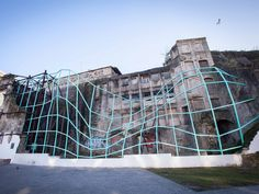 A cyborg spider web, an abstract fossil of urban decay, a glitch in the Tron universe. These are just a few of the images potentially invoked by Metamorfose, a new public installation from local studio FAHR 021.3 in the São Bento area of Porto.