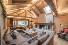 Catered Ski Chalet Gstaad - Chalet de Rougemont - design by PlusDesign - Featured on Leo Trippi's website Wood Fireplace Mantel, Fireplace Design, Leo, Wood Laminate Flooring, Ski Chalet, Beautiful Villas, Wood Ceilings, Leather Sofa, Planer