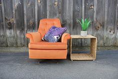 An awesome upholstered chair in a bright tangerine orange. Tufted back and removable base cushion. In overall excellent condition. Base rocks and swivels. Listing is for ONE chair but I have TWO available upon request.  Only offering local NYC/Brooklyn pickup or delivery. $50 for delivery. …………………………………………………………………………… Browse the rest of my shop for more vintage lovelies. GallivantingGirls.etsy.com  I ship WORLDWIDE! Contact me for a quick quote.