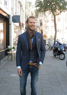 blue Havana jacket, wool scarf and green check bodywarmer with a pair of jeans