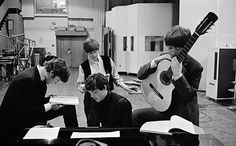 """The Beatles in the Abbey Road Studios, examining the script of """"A Hard Day's Night,"""" London, 1964"""