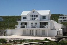 photos of white exterior homes | Beach House 16