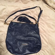 Blue leather Micheal Kors shoulder bag Authentic Navy blue Micheal Kors shoulder bag w tassel . Great condition Price is firm and will not be dropped at all. Michael Kors Bags Shoulder Bags