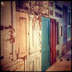 wall of vintage doors. Great on back stairs or long hallow to add a little character