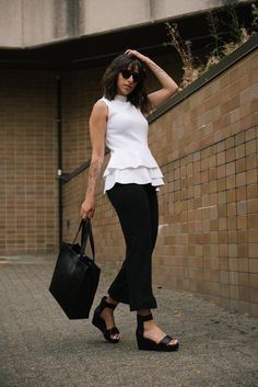 hair flip, hair toss, white peplum shirt, white shirt, forearm tattoo, floral tattoo, cherry blossom tattoo, girls with tattoos, randa salloum, flatform shoes, black shoes, black tote bag.... Would be much cuter & stylish with skinny jeans!