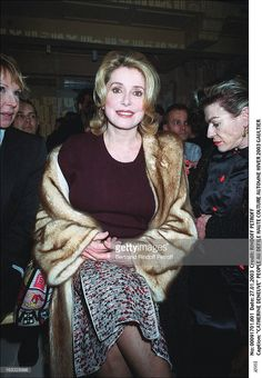 Catherine Deneuve People at the haute couture fashion show fall...