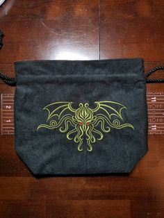 Cthulhu graces the front of this large, fully lined tile/dice bag. Perfect for holding tiles for Arkham Horror, Eldritch Horror, Arkham Horror The Card Game, etc. The bag is 9w x 8h and is gusseted at the bottom so that it will stand on its own open or closed. The large size is great for when you have to stick your hand in and fish around for tiles (Im certainly not judging if you have every expansion to Eldritch Horror), or if you need a bag to hold all your dice collections. An excellent…