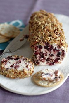 Boozy Cherry Log: Spiked with rum, this pecan-crusted cherry cream cheese log is a surefire way to get the Thanksgiving party started. Click through for more make-ahead Thanksgiving appetizers.
