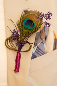 Peacock Boutonnière (good idea, maybe not peacock, since it's bad luck... lol).