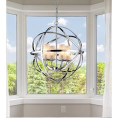 Brilliant and unique, this chandelier will add extra sophistication to your home. The globe design is crafted from crossing bands of metal. The chrome finish gives the chandelier a futuristic look, while  the four lights inside add a classic touch.