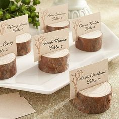Stunningly simple, real-wood stump place card holders add to the beauty of any rustic or nature inspired wedding reception. #rusticwedding #wedding