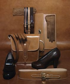 """Various accessories (top to bottom, left to right): Perforated pigskin glove by Daniel Hays; narrow belt in three colors by Criterion; Pigskin belt and brown woven elastic belt, both by Luxenberg; Envelope bag with metal catch by Burkbe; Hand-sewn pigskin gloves by Fownes; Shoulder bag with leather closing by Belt Modes; Fringed tongue """"Mademoiselle Shoe"""" by Carlisle; Russet calf pump by Johansen; Wide cowhide belt with buckled narrow strap fastening by Burkbe."""