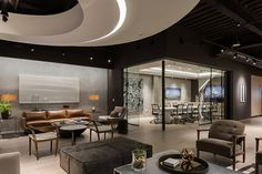 To connect two previously separate levels for Douglas Elliman Real Estate in Los Angeles, Patrick Tighe Architecture built a staircase that also encompasses the reception desk.&...