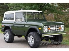 Green Bronco. It\'s not a Range Rover, but it\'s probably closer to our price range.
