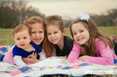 Sweet siblings!  Photo Session Ideas | Props | Prop | Family Photography | Christmas Card Inspiration | Pose Idea | Poses | Quilt |