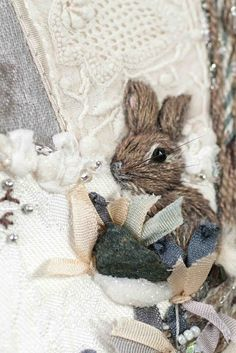 This artist is amazing, her embroidery includes beads, ribbon and found objects