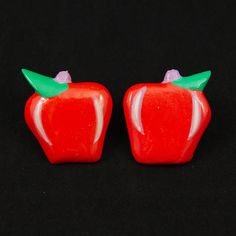 Fruity Apple Earrings:These darling 1 inch red apple earrings will add a little 50s kitsch to your outfit. Light weight and super fun to wear and look delicious! These are a vintage dead stock and have never been worn. $6.00