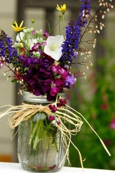 mason jar with flowers wedding centerpiece / http://www.himisspuff.com/rustic-mason-jar-wedding-ideas/