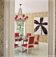 A dining room by Miles Redd with Black Les Touches wallpaper.