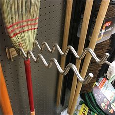 Here Undulating Corn Broom Hooks and Whisk Broom Hooks vary bysize, scale and weight. Corn Brooms hang best on Double Arm Utility or Broom Hooks. Whisk Broom, Garage Tools, Storage Ideas, Clothes Hanger, Hooks, Arm, Deco, Store, Straw Broom