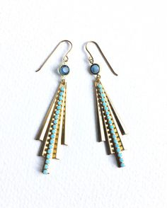 Loving these glamorous geometric blue and gold earrings made with gorgeous vintage Montana blue Swarovski crystals in a brass connector setting with fabulous raw brass ribbed Art Deco fan pendants with 2.3mm turquoise crystal chain running down the centre of them. They hang approximately 8cm and are 18mm wide. They have lovely shaped long ended raw brass ear hooks.  A stunning pair of party earrings, perfect for adding a touch of elegance to an outfit. A great gift for the glamorous…
