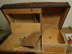 Picture of the inside of a old antique steamer trunk that smells and has odors.