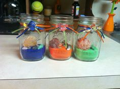 DIY Finding Nemo Party Decorations! These Are The Ones I Made For Kasons Bday! Mason Jar, Colored Sand, Ribbon, Seashells, & Printout Pics Of Nemo Characters!