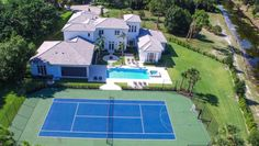 10-Serena-Williams,-Jupiter,-Florida - She was denied a calendar Grand Slam in 2015 but she's winning the game of life—21 career Grand Slam titles, four Olympic gold medals, $75 million in prize money, and several south Florida estates. This includes two pads in Palm Beach Gardens—a 10,687-square-foot estate she shares with sister Venus, and this $2.5 million five-bedroom home (7,370 square feet) on 1.25 acres with tennis court and pool.