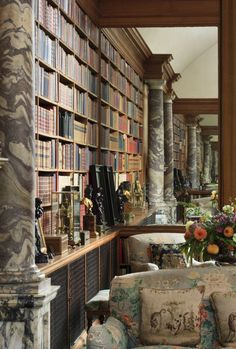 Library with chintz and pillars of Anglesey Abbey in England