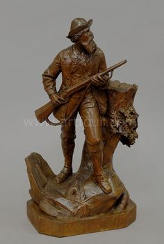great carved wood poacher standing on a stump, swiss brienz