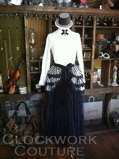 I like THIS style of bustle, because it ties on in the front, much like a hip scarf would.....