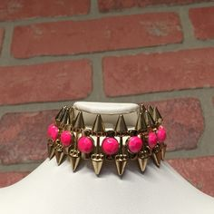 Gold spiked & pink fashion stretch Bracelet Brand new still has tags. Gold and pink, fashion statement  for all you tough cookies!!  Jewelry Bracelets