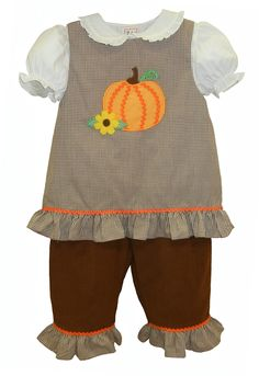 This 3-piece outfit for babies, toddlers, and girls includes brown corduroy pants with a ruffle at the ankle, white short sleeve blouse, and brown gingham top with pumpkin and flower appliques. Perfect outfit for Fall, Halloween, or Thanksgiving. From Zubels by Petit Ami. $39.99