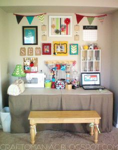 craft room organization- Love the table skirt on the plastic fold up table