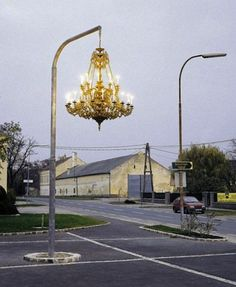 """Style Illuminated blogger @englishmuse shares some """"chandeliers in unexpected places"""". This public art installation of a grand chandelier on a lamppost by artist Werner Reiterer is absolutely stunning!"""