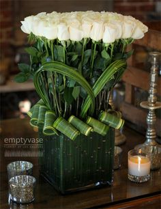 Elegance, simplicity and beauty of white. Love the leaf rolls
